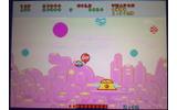ポップで幻想的なステージ構成の「ファンタジーゾーン」を舞台にした、横スクロールシューティングゲームの画像